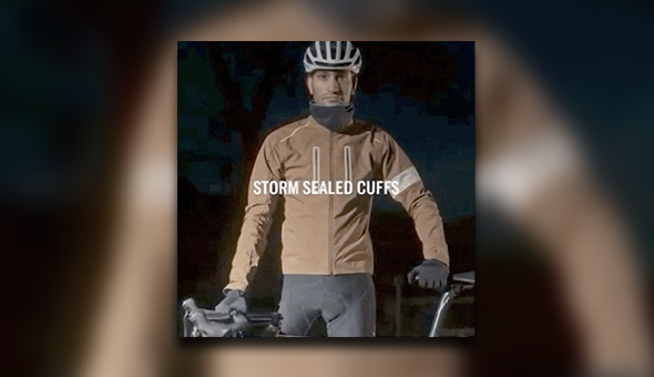 Image of a man wearing a bike helmet looking at the camera with a serious face. The words 'Storm Sealed Cuffs' is in the center of the image.