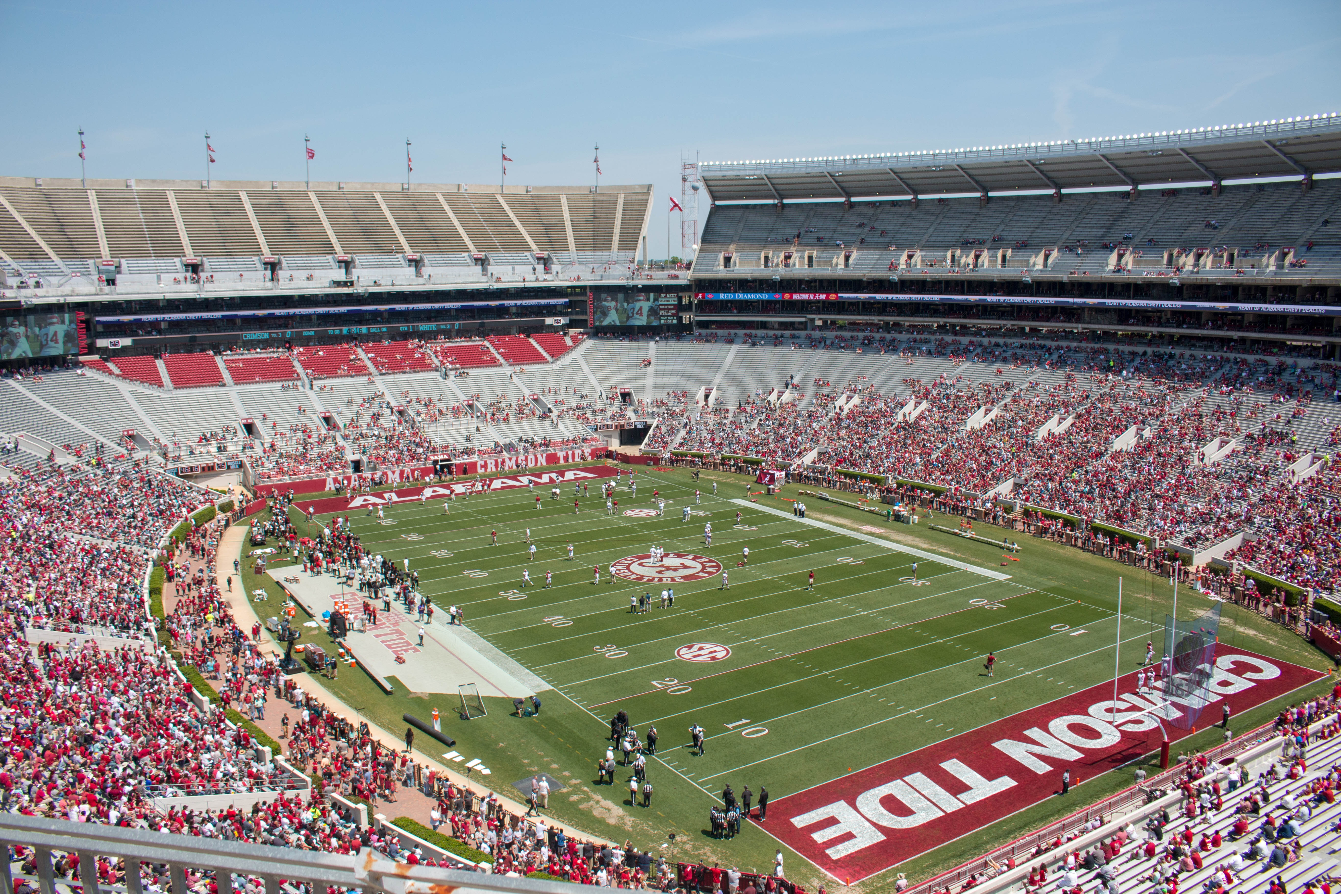 A university football field on game day with the stands filled with fans